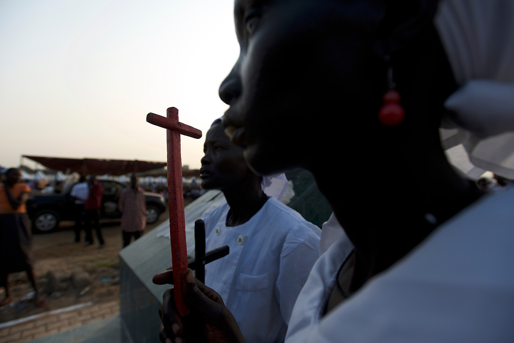 Religious women take part in a praying session, in central Juba, ahead of the official ceremony marking South Sudan as an independent nation.