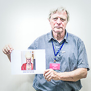 2018<br /> George Maid, a survivor and activist from Seattle, poses for a portrait showing a picture of the bishop Richard Malone from Buffalo that he purposely omitted cases of abuses in Buffalo. © Simone Padovani