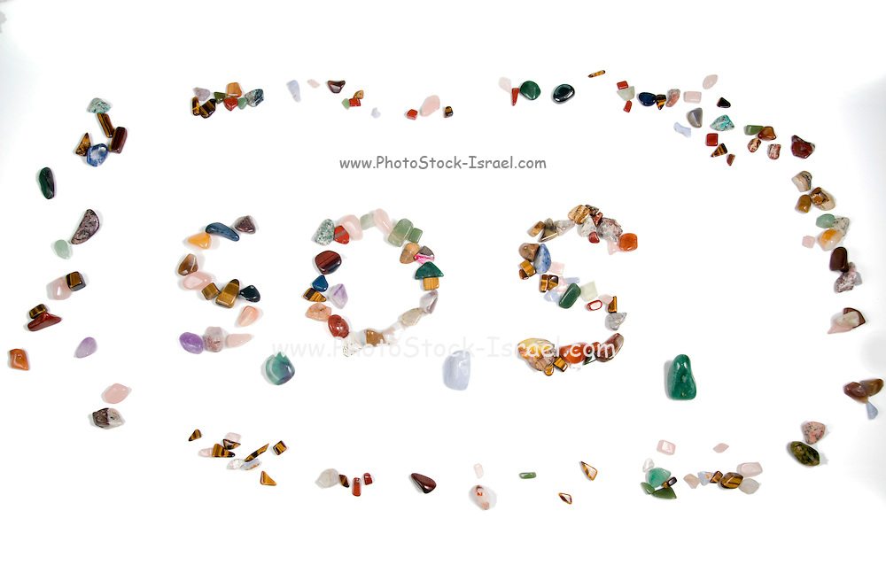Spelling out S.O.S with stones the international rescue call
