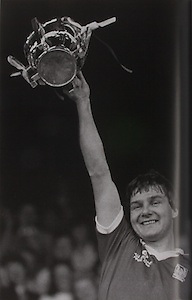 Tom Cashman shows the McCarthy Cup to the Cork supporters. His brother Jim was also on the team. Their father Mick had played in goal in the epic final between Cork and Wexford 30 years earlier in 1956.