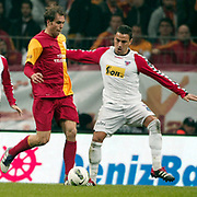 Galatasaray's Johan ELMANDER (L) during their Turkish Superleague soccer match Galatasaray between Mersin Idman Yurdu at the Turk Telekom Arena at Aslantepe in Istanbul Turkey on Saturday 05 November 2011. Photo by TURKPIX