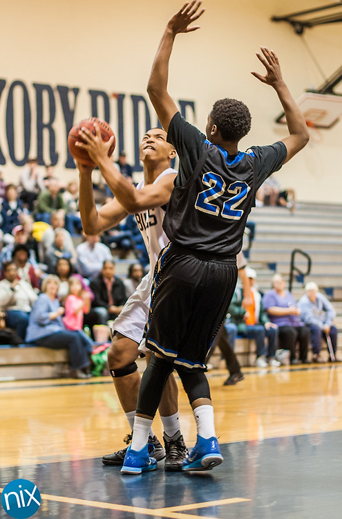 Hickory Ridge's Andrew Metcalf (10) looks to shoot against McMichael's Tyrique Williams (22) during the first round of the NCHSAA 3A playoffs Saturday afternoon in Harrisburg. Hickory Ridge won the game 80-63.