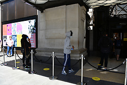 © Licensed to London News Pictures. 15/06/2020. London, UK. Customers enter the Selfridges Store in Regent St as it reopens following a relaxation of Covid-19 rules. Non-essential shops can reopen today following strict government regulations. London, Britain, Jun 15, 2020. (Photo by Ray Tang/Xinhua). Photo credit: Ray Tang/LNP