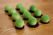 Puffs. Balls of pistachio flavoured mousse on a biscuit base