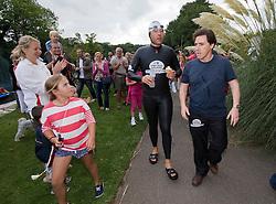 © licensed to London News Pictures. London, UK.  10/09/2011. David Walliams holding a cup-cake talking to comedian Rob Brydon (right) as he briefly leaves  River Thames at Boveney Lock near Windsor, Berkshire today (10/09/2011) during day 6 of his Sport Relief Challenge 'Wallians Vs The Thames'. Photo credit: Ben Cawthra/LNP