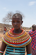 Young woman of the Samburu tribe. The Samburu are a Nilotic people of north-central Kenya. Samburu are semi-nomadic pastoralists who herd mainly cattle but also keep sheep, goats and camels.