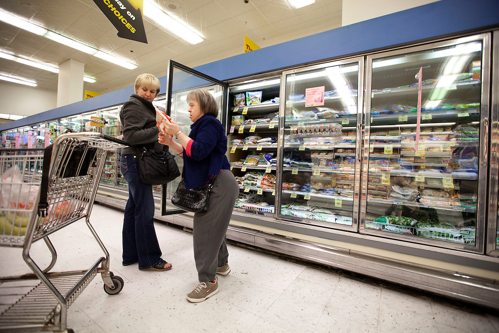 Companion Tonia Kulig helps Mary Beth Solinski, a 59 year old, with Down Syndrome with her grocery shopping at Dominick's grocery store...Aging adults with Down Syndrome. In 1983, people with Down syndrome could expect to live to age 25. Today, their life expectancy is 60 years. We interview a 59-year-old patient who has outlived her parents and is now in AARP. She has trouble walking, but has lots of interests, such as cooking, arts and crafts and reading.