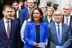 © Licensed to London News Pictures. 24/09/2019. London, UK. Businesswoman and political activist GINA MILLER makes a statement outside Supreme Court in London after the court ruled that the Prime Minister Boris Johnson's decision to prorogue Parliament is unlawful. Last week the court heard an appeal in the multiple legal challenges against the Prime Minister Boris Johnson's decision to prorogue Parliament ahead of a Queen's speech on 14 October.  Photo credit: Dinendra Haria/LNP