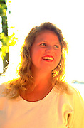Woman age 30 happily glowing in the sun. Big La Salle Island Les Cheneaux Islands Lake Huron Cedarville  Michigan USA