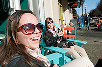 Taylor laughs with a friend as they pause while shopping in downtown Victoria, BC Canada
