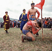 """Mongolian wrestling (Mongolian: bökh) is a traditional sport that has existed in Mongolia for centuries.<br /> Wrestling is one of Mongolia's age-old """"Three Manly Skills"""" (along with horsemanship and archery).<br /> The wrestler is dressed in an open-chested wrestling shirt, called a zodog.<br /> Mongolian's nomadic lifestyle and traditions."""