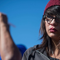 A tear rolls down the face of Desiree John, cousin to Loreal Tsingine at the Justice for Loreal vigil in front of the Winslow Police Department Saturday. Tsingine was fatally shot five times by Winslow police officer after allegedly threatening the officer with a pair of scissors Sunday March 27.