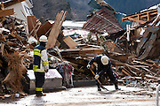 Firemen begin recovery operations after the tsunami in Ofunato, Iwate, Japan. March 17th 2011