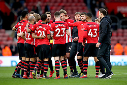 Southampton manager Ralph Hasenhuttl (fourth right) and the Southampton players huddle together to celebrate the result at the end of the Premier League match at St Mary's Stadium, Southampton.