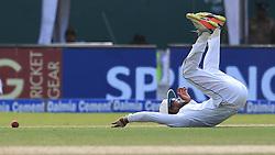 August 4, 2017 - Colombo, Sri Lanka - Sri Lankan cricket captain Dinesh Chandimal stops a ball hit by Indian cricketer Ravindra Jadeja  (Credit Image: © Tharaka Basnayaka/NurPhoto via ZUMA Press)