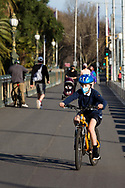A young boy wearing a facemask is seen riding along the Princes Bridge during COVID-19 in Melbourne, Australia. Hotel quarantine linked to 99% of Victoria's COVID-19 cases, inquiry told. This comes amid a further 222 new cases being discovered along with 17 deaths. Melbourne continues to reel under Stage 4 restrictions with speculation that it will be extended. (Photo by Dave Hewison/Speed Media)