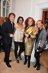 Left to right, SIR PAUL McCARTNEY, DAME KELLY HOLMES,  JENNIFER SAUNDERS as her TV character Edina Monsoon and EMMA BUNTON at a party to celebrate the switching on of the Christmas Lights at the Stella McCartney store, Bruton Street, London on 29th November 2011.