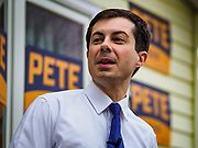"""17 APRIL 2019 - MARSHALLTOWN, IOWA:  Mayor PETE BUTTIGIEG talks to voters during a meet and greet at home in Marshalltown, Iowa. People came from as far away as Minneapolis, Minnesota and Rockford, Illinois to meet the mayor of South Bend, Indiana. """"Mayor Pete,"""" as he goes by, declared his candidacy to be the Democratic nominee for the US Presidency on April 14. Buttigieg is touring Iowa this week. Iowa traditionally hosts the the first selection event of the presidential election cycle. The Iowa Caucuses will be on Feb. 3, 2020.              PHOTO BY JACK KURTZ"""