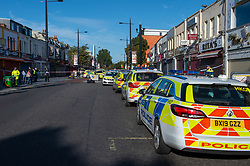 © Licensed to London News Pictures. 23/09/2019. London, UK. Emergency services at the scene where a man in his 20's was found injured outside a shop in The Broadway, Southall. The man was taken to hospital suffering from a stab injury; he we was pronounced dead at 05:26 BST. Photo credit: Peter Manning/LNP