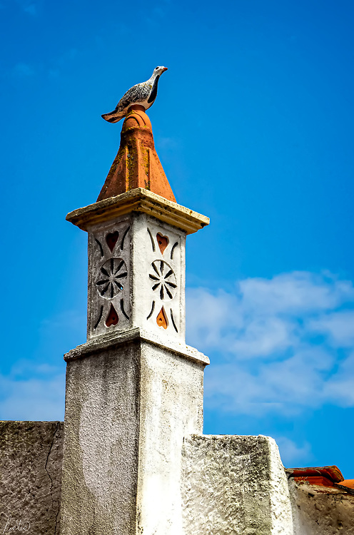 A Chimney in Tavira, Portugal with a Bird Ornament