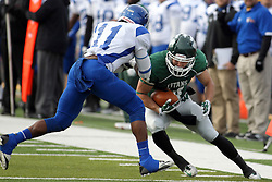 15 November 2014:  Artie Checchin  braces against P. Pendleton during an NCAA division 3 football game between the North Park Vikingsand the Illinois Wesleyan Titans in Tucci Stadium on Wilder Field, Bloomington IL