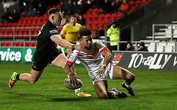 St Helens Saints' Regan Grace goes over for a try past London Broncos' Matty Fleming, during the Betfred Super League match at the Totally Wicked Stadium, St Helens.