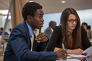 Purchase, NY – 31 October 2014. Awa  Nymabi, left, and Kaltrina Celaj of the Woodlands High School team. Woodlands High School went on to place second in the 2014 competition. The Business Skills Olympics was founded by the African American Men of Westchester, is sponsored and facilitated by Morgan Stanley, and is open to high school teams in Westchester County.