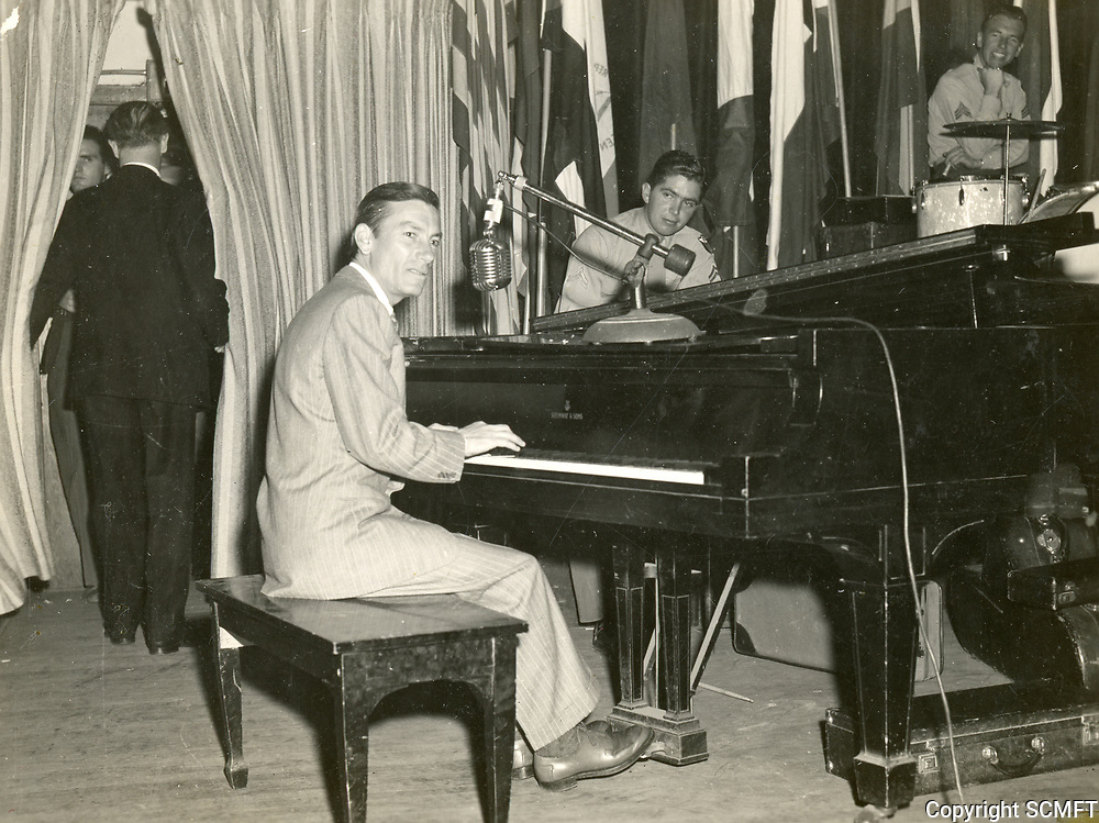 11/22/45 Hoggy Carmichael plays the piano with the 684th Army Air Force Band on the closing night the Hollywood Canteen.