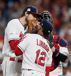 October 5, 2017 - Cleveland, OH, UKR - Cleveland Indians pitcher Andrew Miller talks with shortstop Francisco Lindor (12) as he enters the game in the seventh inning against the New York Yankees in Game 1 of the American League Division Series on Thursday, Oct. 5, 2017, at Progressive Field in Cleveland. (Credit Image: © Leah Klafczynski/TNS via ZUMA Wire)