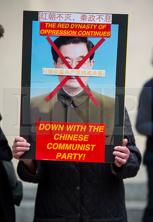 © Licensed to London News Pictures. 20/10/2015. London UK. An anti China protestor stand on The Mall close to Buckingham Palace as Chinese President Xi Jinping starts day one of a four day State Visit to the United Kingdom. Photo credit: Ben Cawthra/LNP