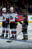 KELOWNA, BC - FEBRUARY 17: Jake Lee #21 of the Kelowna Rockets taps the stick of the Pepsi Player during pre game introductions against the Calgary Hitmen at Prospera Place on February 17, 2020 in Kelowna, Canada. (Photo by Marissa Baecker/Shoot the Breeze)