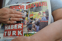 August 18, 2017 - Ankara, Turkey - A woman holds a copy of Turkey's one of mayor daily newspapers Haberturk in Ankara, Turkey on August 18, 2017 as the daily depicts the terror attack on Barcelona's Las Ramblas on its front page with a headline that reads 'The terror boulevard' a day after a van ploughed into the crowd, killing 13 people and injuring over 100. (Credit Image: © Altan Gocher/NurPhoto via ZUMA Press)