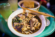 """Bowl of traditional vietnamese dish """"my ga tan"""", a chicken noodle soup with an herbal based broth. Hanoi, Vietnam, Southeast Asia"""