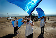pvcSWHS1/9-13-07/WEST.  Members of the West Mesa High School Marching Band Color Guard (L-R) Tiffany Jones (CQ) age 15, captain Hannah Vallejos (CQ) age 15, and Ashley LaGrange (CQ) age 15 (All are sophomores) rehearse with their band before a ground breaking ceremony for the new Southwest Mesa high school, photographed Thursday Sept. 13, 2007.  (Pat Vasquez-Cunningham/Journal)