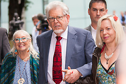 London, June 27th 2014. With the jury still to reach a verdict on the 12 charges of indecent assault against girls aged between 7 and 19, at the end of their 7th day in retirement, Rolf Harris, who denies the charges, leaves court with his wife Alwen and daughter Bindi.
