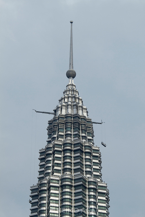 Malaysia, Kuala Lumpur. Window cleaners at the top of Petronas Twin Towers, the tallest buildings on Earth from 1998-2004 (still the tallest twin buildings).