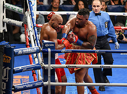 July 29, 2017 - Brooklyn, New York, USA - JARRELL MILLER (red trunks with gold trim) and GERALD WASHINGTON battle in a heavyweight bout at the Barclays Center in Brooklyn. (Credit Image: © Joel Plummer via ZUMA Wire)