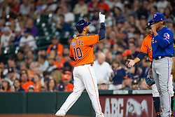 April 13, 2018 - Houston, TX, U.S. - HOUSTON, TX - APRIL 13: Houston Astros first baseman Yuli Gurriel (10) reacts after hitting a single in the second inning during an MLB game between the Houston Astros and the Texas Rangers on April 13, 2018 at Minute Maid Park in Houston, TX.. (Photo by Juan DeLeon/Icon Sportswire) (Credit Image: © Juan Deleon/Icon SMI via ZUMA Press)