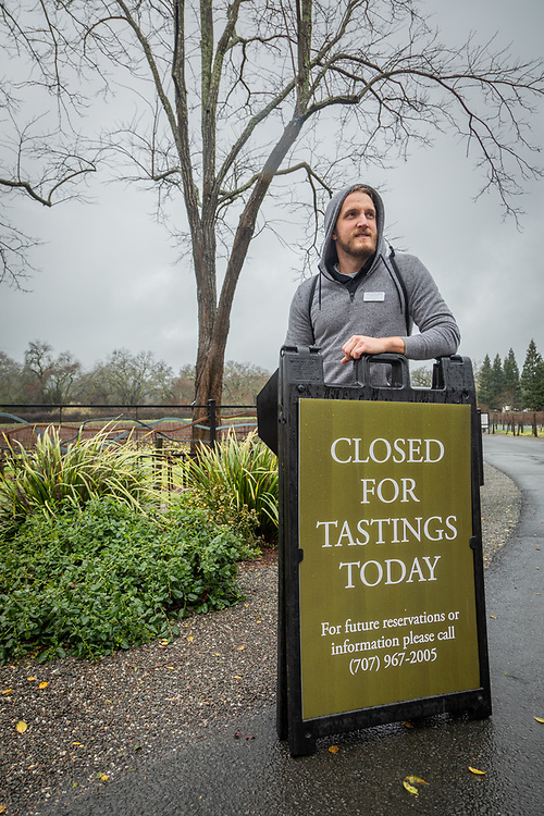 """We're closing the flood gates as a precaution and closing for the day. We want to make sure everyone gets home safely.""""   -Before heading home for the day, Duckhorn Winery employee Josh Martin sets out signs during a day of heavy rains and flooding near the Napa River."""
