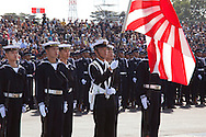 October, 23, 2016, Asaka, Saitama Prefecture, Japan: Flying the old and traditional rising sun flag, members of the Japan Maritime Self Defense Force flaunt their colors during an annual military review held at the Asaka Training Area, a Japan Ground Self Defense Force (JSDF) base on the outskirts of Tokyo. For this event, Prime Minister Shinzo Abe, top ranking Japanese brass and international dignitaries were in attendance to view Japan's military might. This included 4000 troops, 27 divisions, 280 vehicles and artillery, plus 50 aircraft of the Ground, Air, and Maritime branches of the JSDF. (Torin Boyd/Polaris).