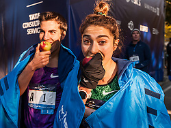 winners Donn Cabral and Alexi Pappas bite the big apple