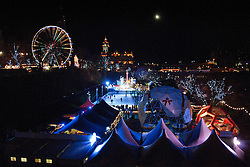 People enjoying the various attractions including a ferris wheel and ice ring after the Christmas lights of the city of Edinburgh were switched on in Scotland today (Thursday). A 20m Christmas tree was lit by acrobats and all the city's main lights switched on in major thoroughfares like Prince's Street and adjacent areas England, 25 November 2010. Picture by Jonathan Mitchell / i-Images