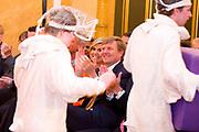 Koningin Maxima reikt Appeltjes van Oranje uit op Paleis Noordeinde / Queen Maxima at the Apples of Orange at Noordeinde Palace.<br /> <br /> Op dew foto / On the photo:  Koningin Maxima en Koning Willem Alexander / Queen Maxima and King Willem Alexander