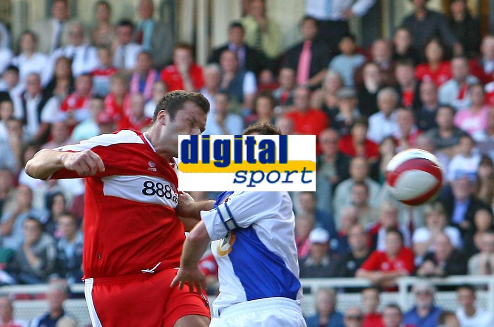 Photo: Andrew Unwin.<br />Middlesbrough v Blackburn Rovers. The Barclays Premiership. 23/09/2006.<br />Middlesbrough's Mark Viduka (L) battles with Blackburn's Lucas Neill (R).