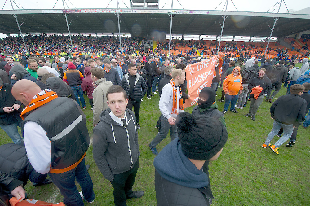 Blackpool fans stage a protest and pitch invasion against the running of the club by owner Owen Oyston.<br /> The match was later abandoned by match referee Mick Russell<br /> <br /> Photographer Stephen White/CameraSport<br /> <br /> Football - The Football League Sky Bet Championship - Blackpool v Huddersfield Town - Saturday 2nd May 2015 - Bloomfield Road - Blackpool<br /> <br /> © CameraSport - 43 Linden Ave. Countesthorpe. Leicester. England. LE8 5PG - Tel: +44 (0) 116 277 4147 - admin@camerasport.com - www.camerasport.com