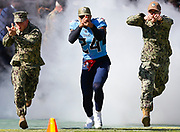 Tennessee Titans cornerback Kenny Vaccaro runs out during pre-game with US military members before the game against the Kansas City Chiefs.