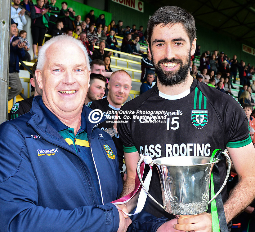 John Kavanagh, Vice Chairman, Meath county Board, persents the 'Corn Tailteann Cup' to the winning st Ultan's captain, Gearoid Rennicks, after St Ultan's won the St Ultan's v St Vincents, Taillteann Cup Final match at Pairc Tailteann, Navan.<br /> <br /> Photo: GERRY SHANAHAN-WWW.QUIRKE.IE<br /> <br /> 17-08-2019