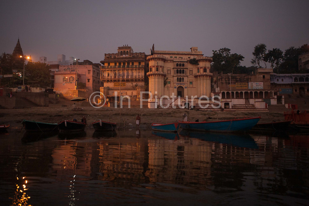 The river ganges from a boat at dawn on 21st December 2009, Varanasi / Benares, Uttar Pradesh, India. According to Hindu mythology, Varanasi was founded by Shiva, one of three principal deities along with Brahma and Vishnu, and is seen as a significant and holy place to followers of the Hundu faith. .