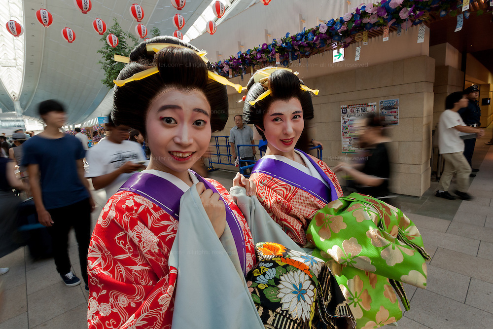 Actresses dressed as Geisha in ornate kimono during the Edo festival at Haneda International Airport terminal, Tokyo, Japan. Friday August 26th 2016. The 3 day festival runs from August 26th to August 28th at Tokyo's second International airport. Actors dressed as samurai, geisha and ninja will greet passengers and visitors to the terminal and put on shows and parades of traditional music and dance. Haneda International airport has an Edo theme. Edo is the old name for Tokyo in the time of the samurai