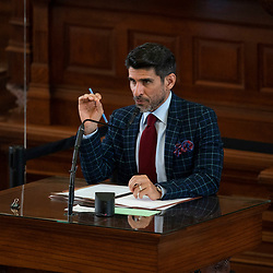 Austin, TX USA March 31, 2021:  State Rep. Eddie Lucio, Jr. D-Brownsville, on the floor of the Texas House of Representatives during routine bill readings at the 87th Texas legislative session. Emergency bills include power company regulation, border security and the coronavirus response.